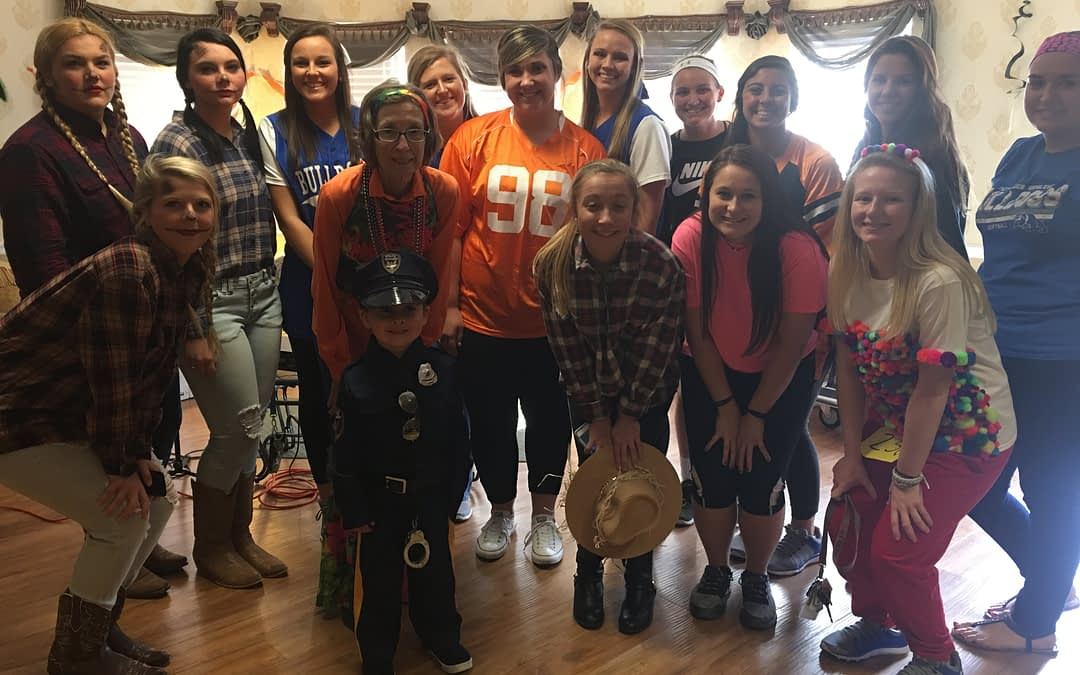 TWU Softball Team Judges Ghouliest of Costumes at Morning Pointe Halloween Party