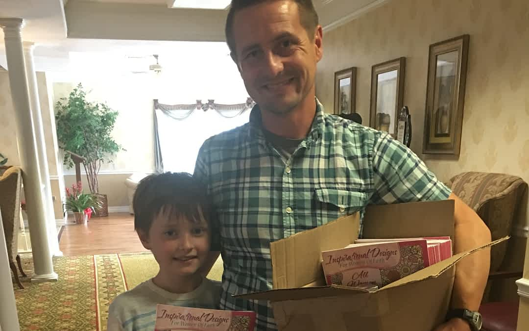 Pastor Jamey Davis of First Baptist Church of Decatur delivers gifts with his son Elisha at Morning Pointe of Athens.