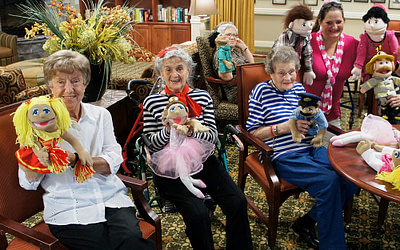 Morning Pointe Associate Stages Puppet Show for Residents