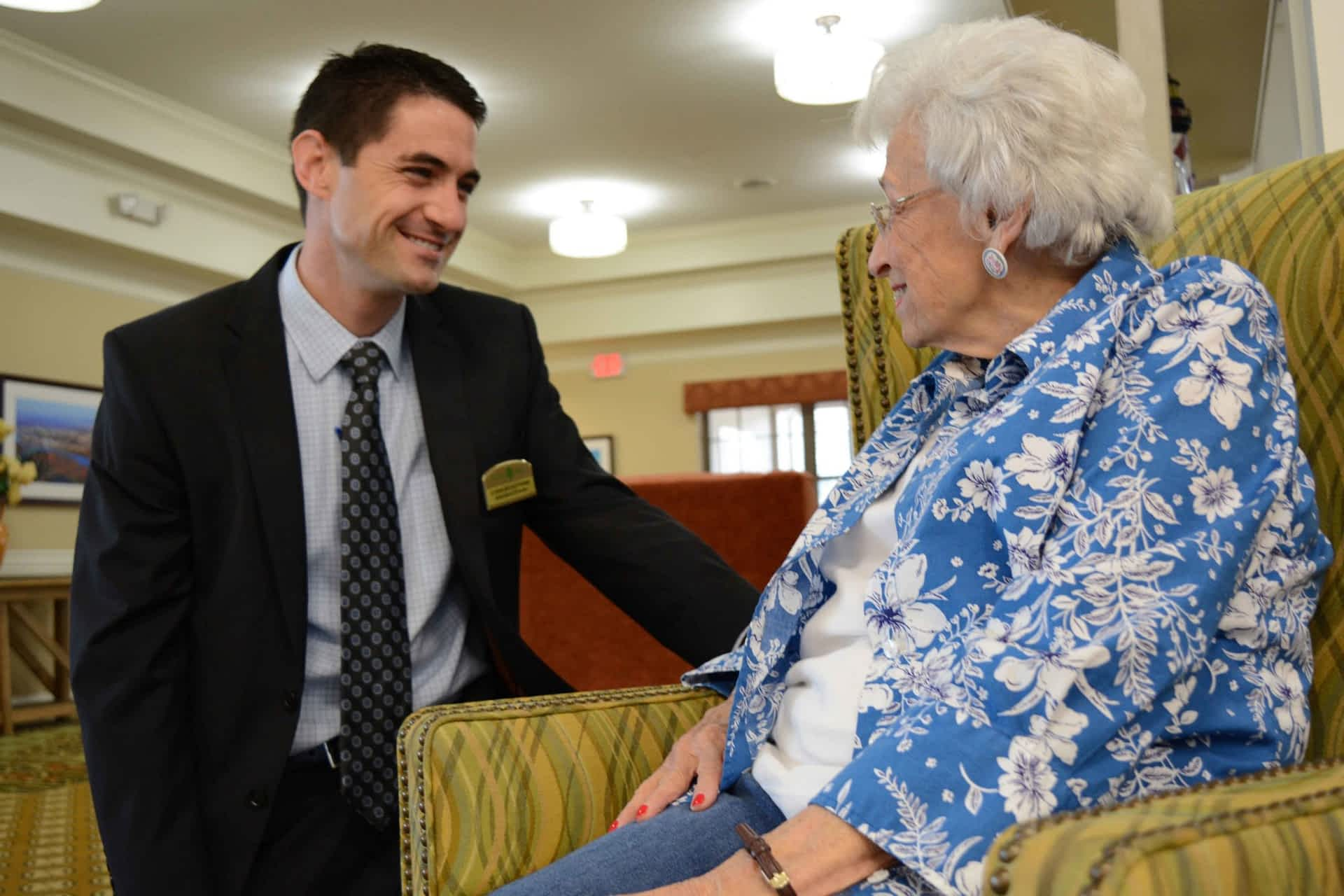 Executive Director at Morning Pointe engaging with resident
