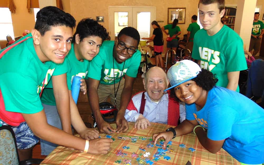 Andrew Calderon, Steven Roman and Julien Magloire, Jan Greenleaf and Demani White from the Summer Cool Camp at Collegedale Seventh-day Adventist Church, with George Baehm, The Lantern at Collegedale resident (center).