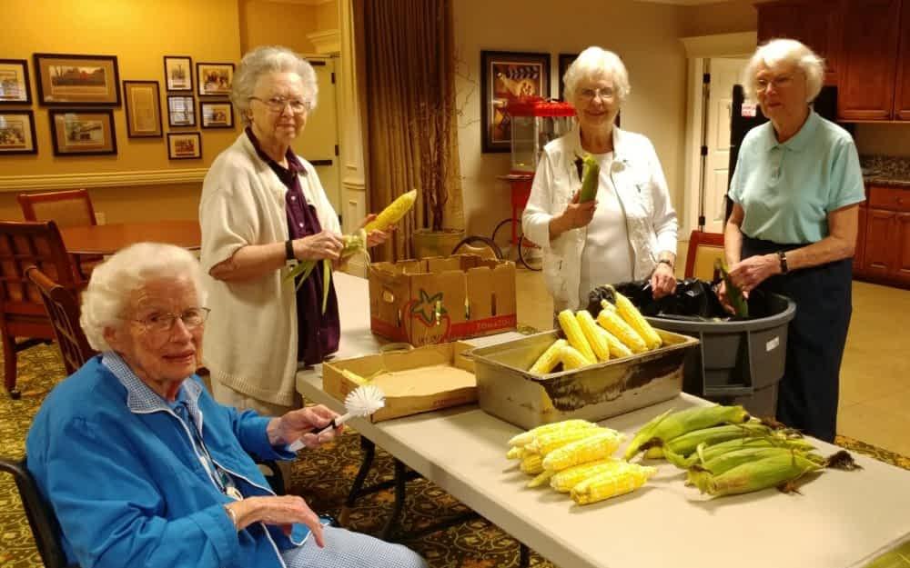 Corn Shucking at Morning Pointe, Residents Enjoy Farm Fresh Produce