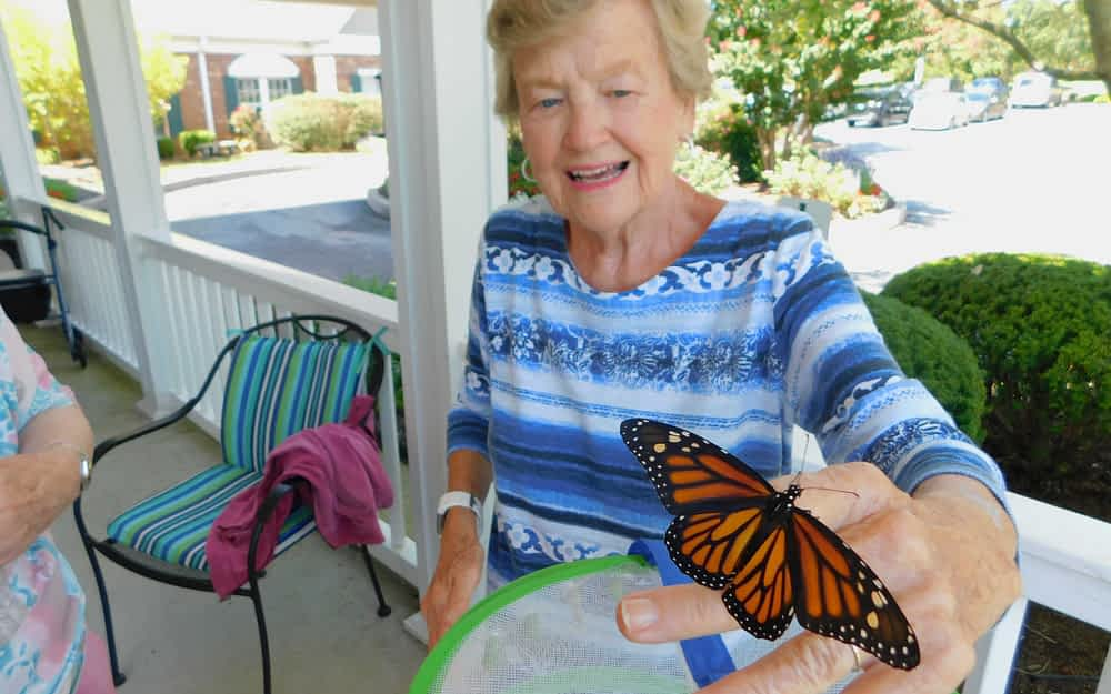 Morning Pointe Releases Butterflies with Neighbor