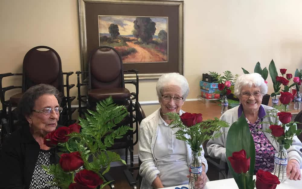 Volunteer Brightens Morning Pointe Residents Days With Flowers