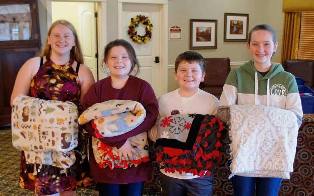 Young Volunteers Give Out Handmade Blankets at Morning Pointe