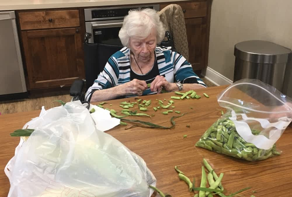 Snapping Beans Sparks Memories of Farm Life for Morning Pointe Resident