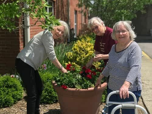 Morning Pointe Residents Volunteer in Capital City Activity Center Garden