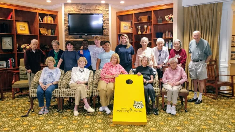 Hixson Middle Summer Camp Plays Cornhole with Morning Pointe Residents