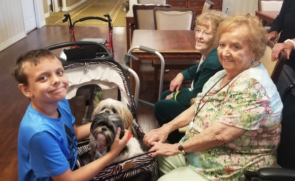 Young Volunteers, Therapy Dogs Brighten Morning Pointe Residents' Independence Day