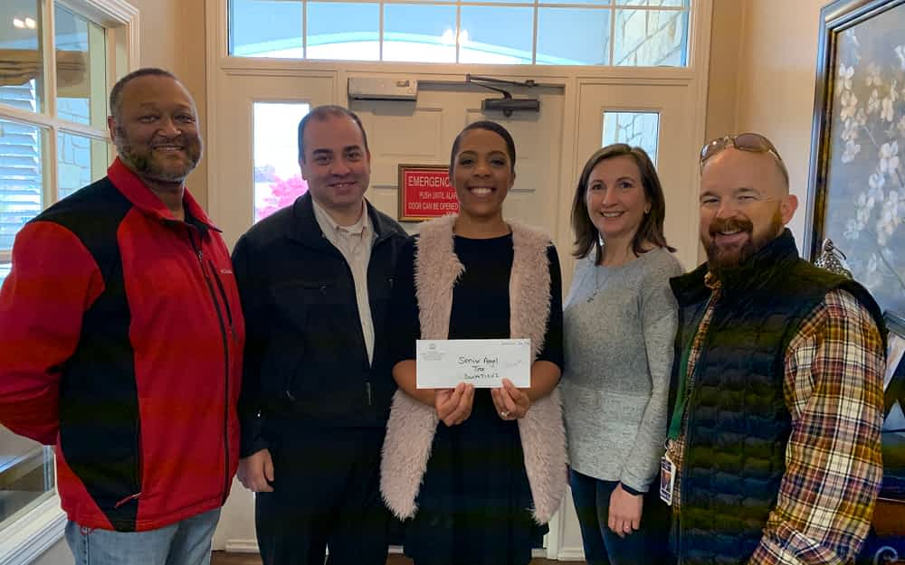 Local TBI Office Makes Generous Donation to Morning Pointe's Angel Tree