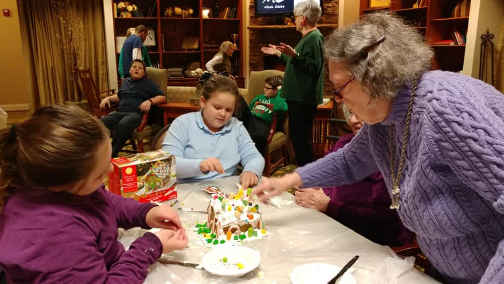 Skyuka Students, Morning Pointe Residents Build Gingerbread Houses