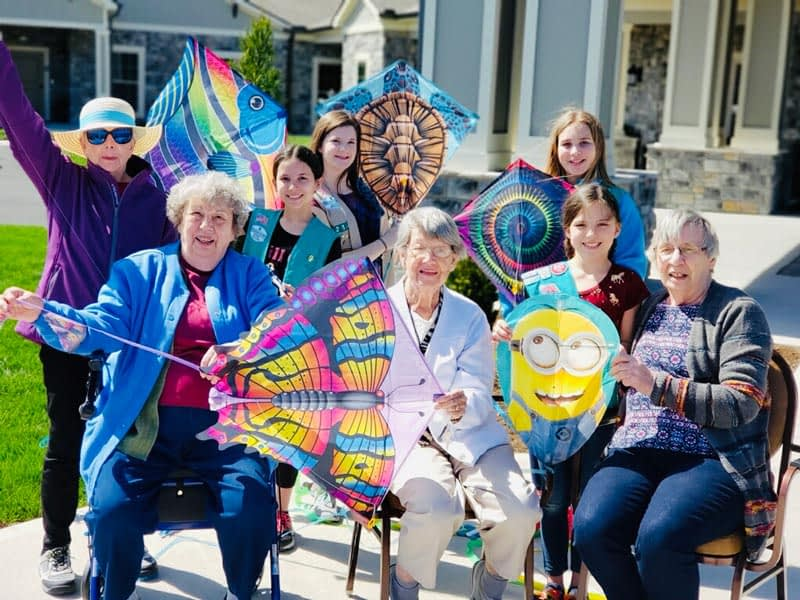 Local Girl Scouts Fly Kites with Morning Pointe Residents