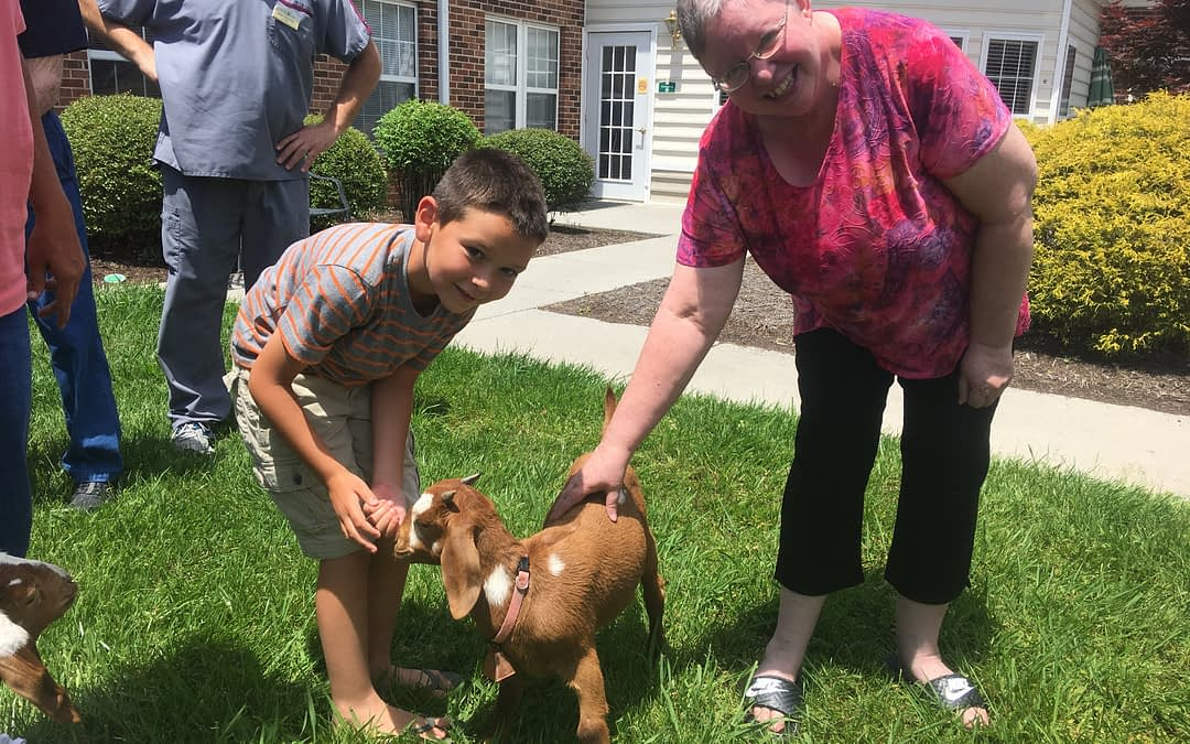 Morning Pointe Residents Greet Goats