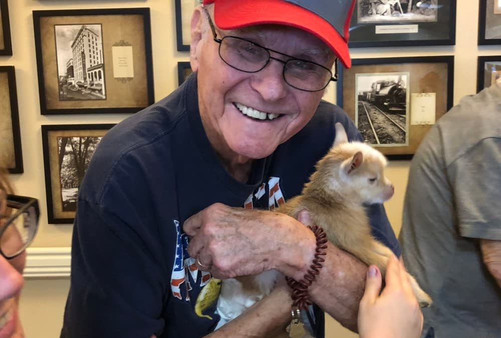 Morning Pointe Residents Charmed by Baby Goat Visitor