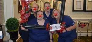 """Morning Pointe of Louisville residents and associates enjoyed getting silly to celebrate 'Red Nose Day"""" during a luncheon at the senior living and memory care community."""